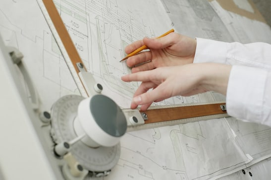 An image of two architects' hands doing work - image licensed from Photodune